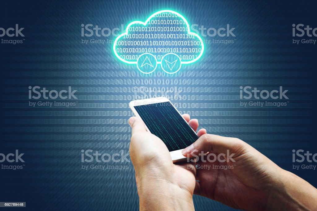 Cloud computing connectivity concept and hand man using smartphone network system and binary background. stock photo