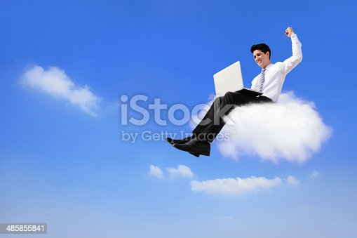 business man sitting on a cloud working with laptop, low angle view, cloud computing concept