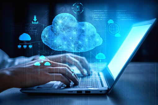 Cloud computing technology and online data storage for business network concept. Computer connects to internet server service for cloud data transfer presented in 3D futuristic graphic interface.