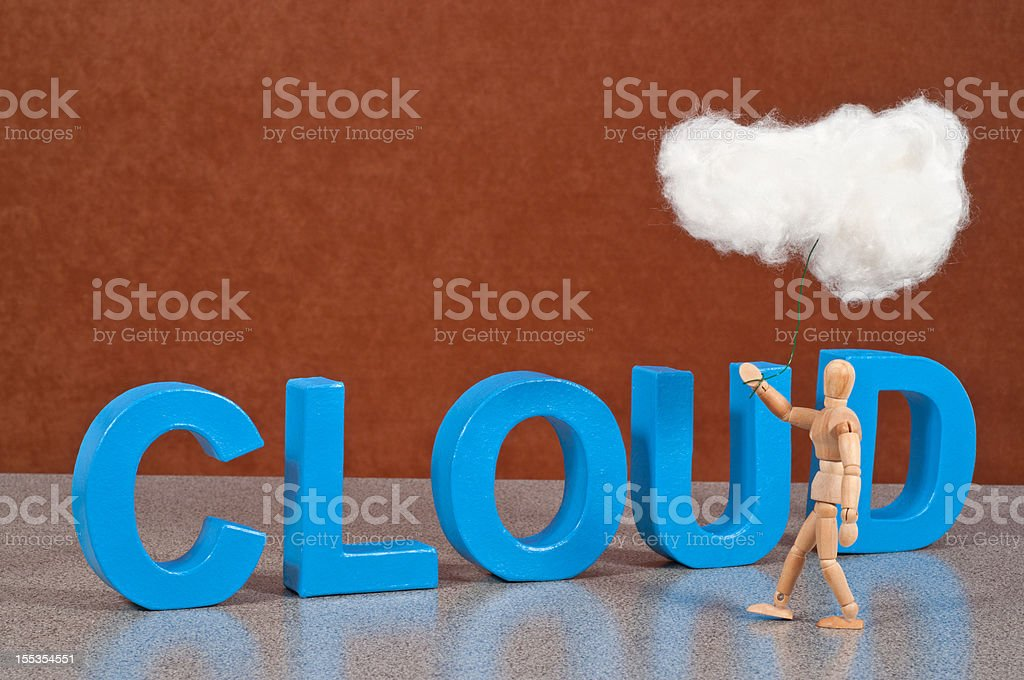 Cloud computing - Wooden Mannequin demonstrating this word stock photo
