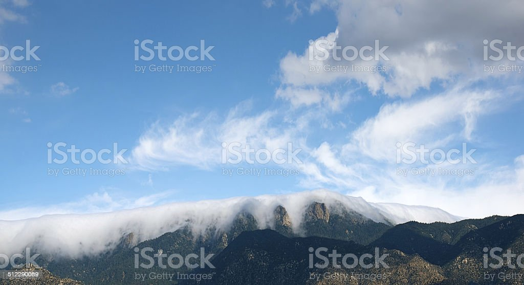 Cloud Covered Sandia Mountains stock photo