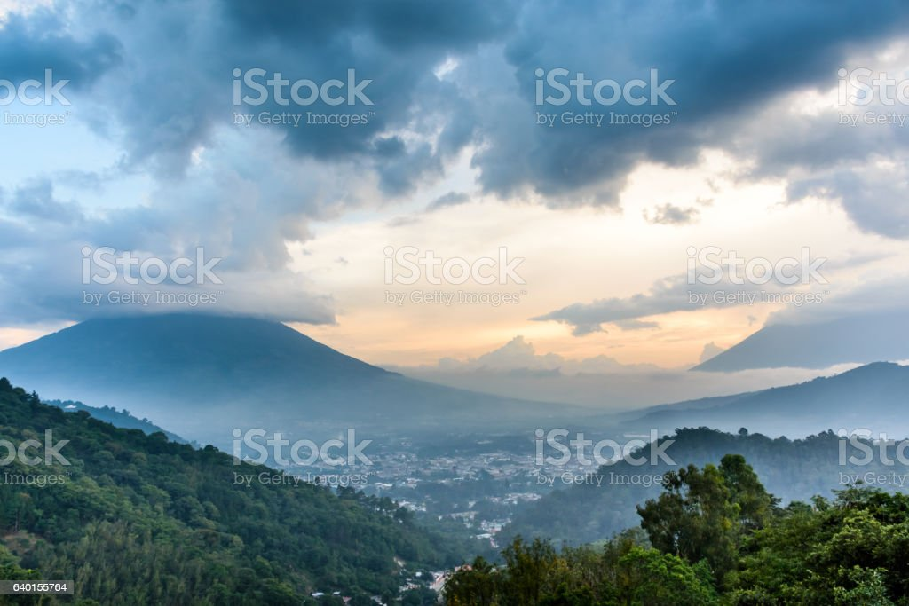 Cloud covered volcanoes at sunset, Antigua, Guatemala stock photo