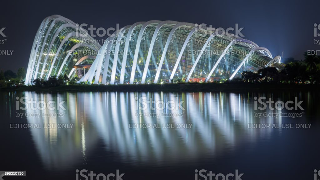 Cloud Forest and Flower Dome illuminated at night. Gardens by the...