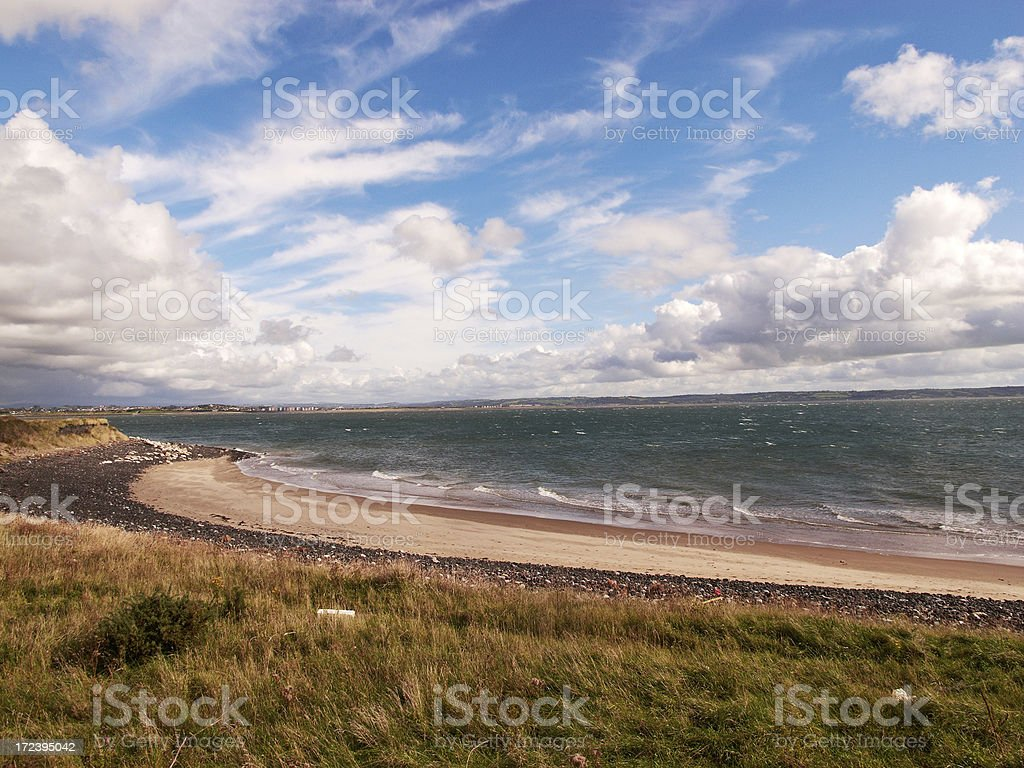 Cloud formation above Welsh bay royalty-free stock photo
