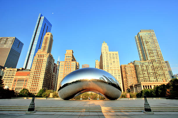 cloud gate in millennium park at sunrise, chicago - bean stock photos and pictures