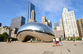 Chicago, Illinois, USA - August 26, 2012: People looking and taking pictures of the Cloud Gate in Millennium park, Chicago