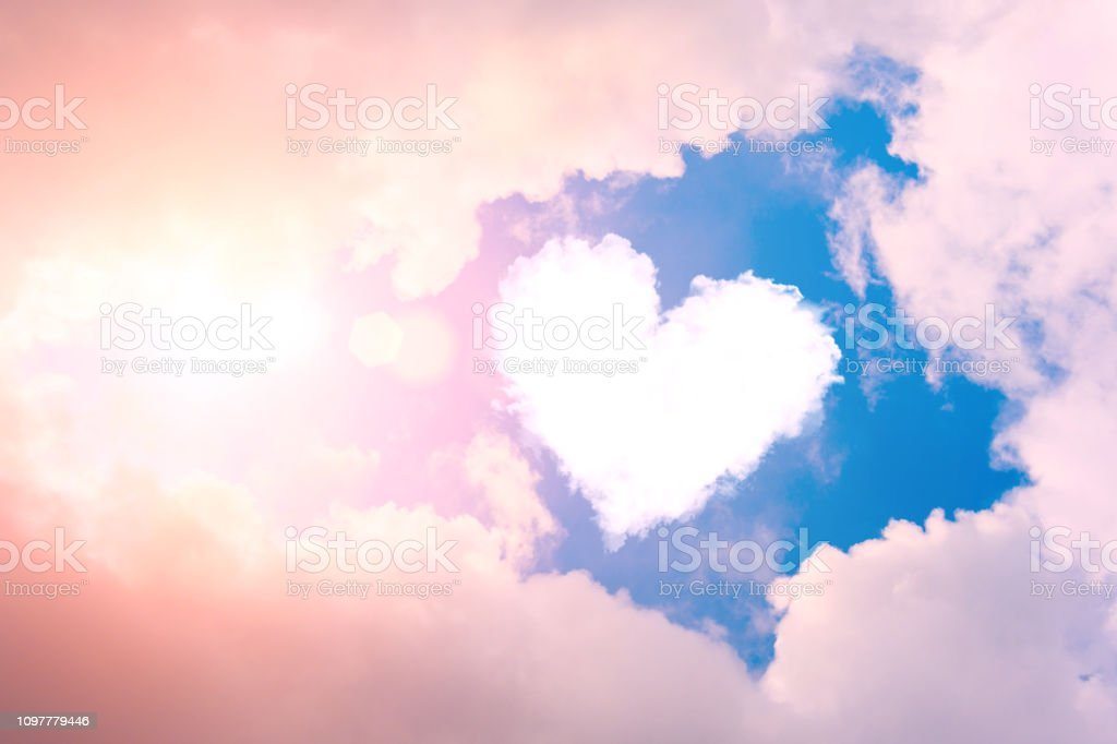 Cloud heart in the sky in the clouds and sunshine. Cloud heart in the sky in the clouds and sunshine Abstract Stock Photo