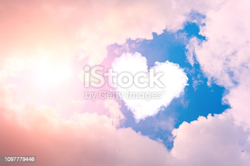istock Cloud heart in the sky in the clouds and sunshine. 1097779446