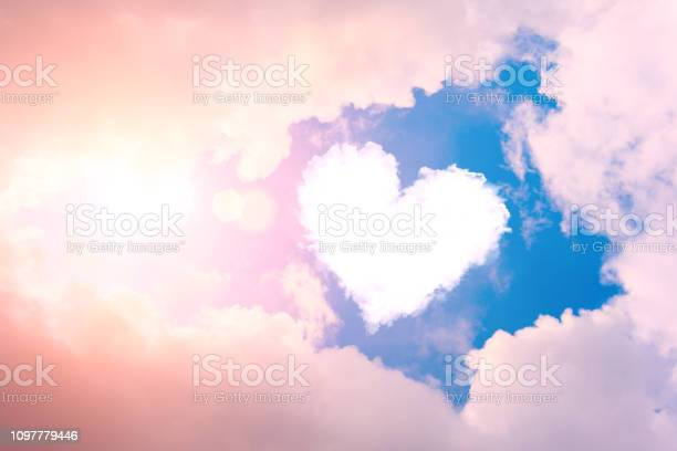 Photo of Cloud heart in the sky in the clouds and sunshine.