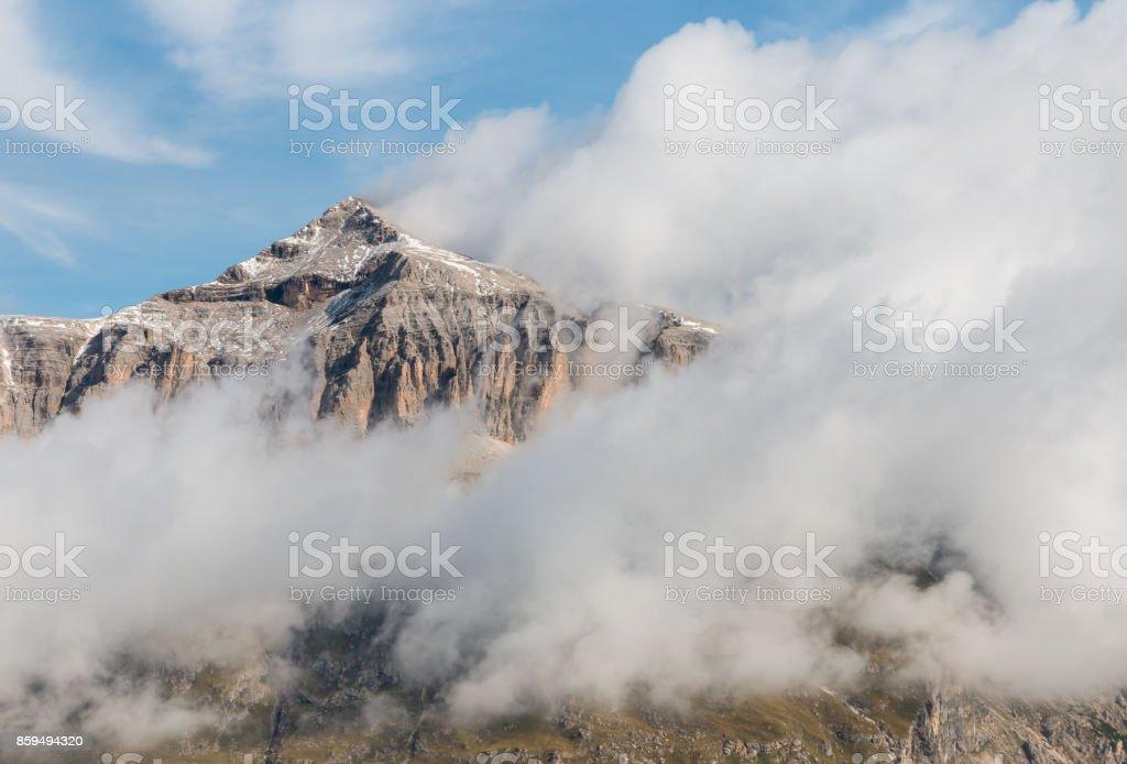 cloud inversion around Piz Boe peak in Dolomites stock photo