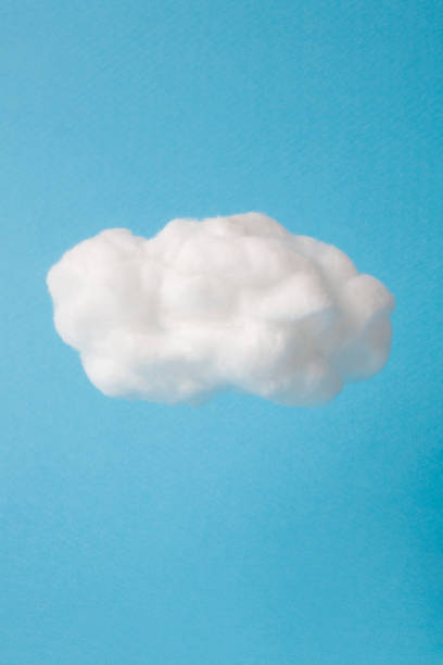 cloud made out of cotton wool on sky blue background - clouds stock photos and pictures