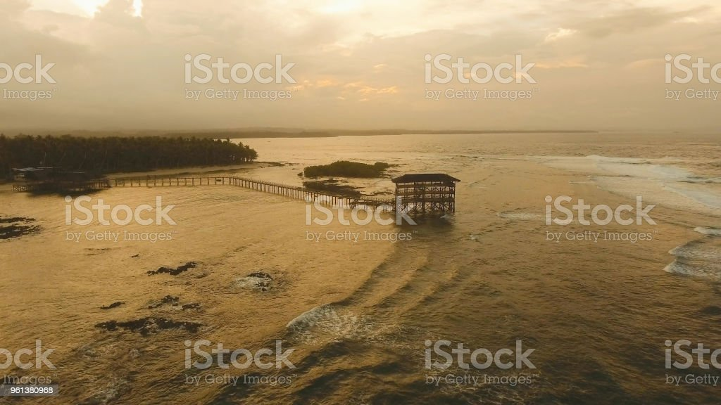 Viewpoint in the ocean at Cloud Nine surf point at sunset, Siargao...