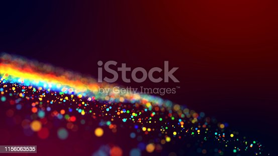 a cloud of multicolored particles in the air like sparkles on a dark background with a small depth of field. beautiful bokeh light effects with colored particles. background for holiday presentations