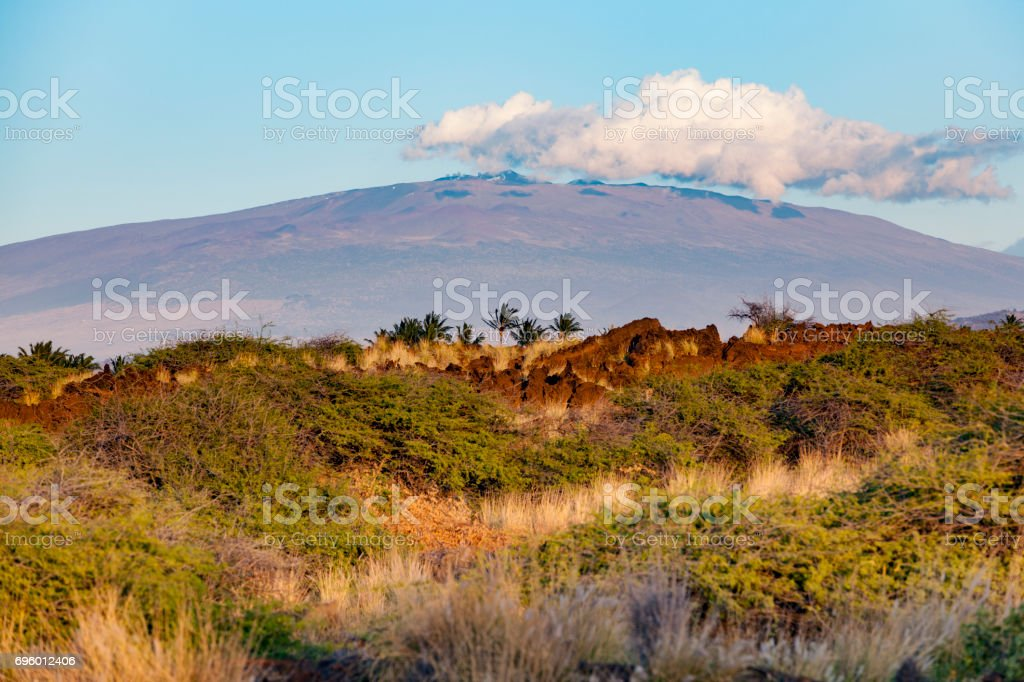 cloud over mauna kea volcano hawaii stock photo