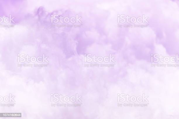 Photo of Cloud series : Colorful cotton candy. Soft fog and clouds with a pastel colored purple for background.