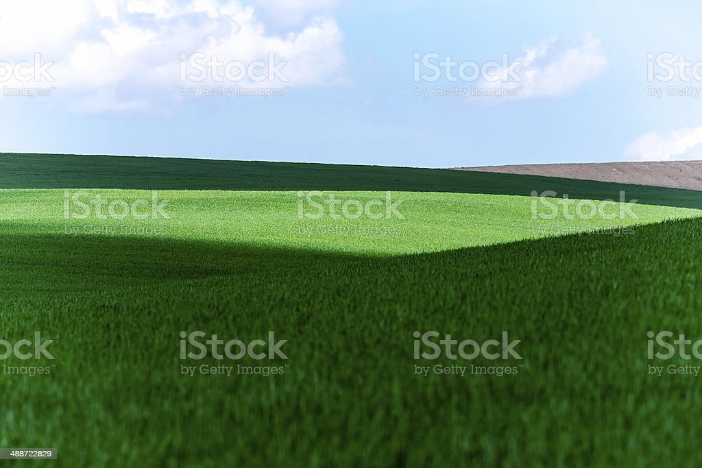 cloud shadow on green fields royalty-free stock photo