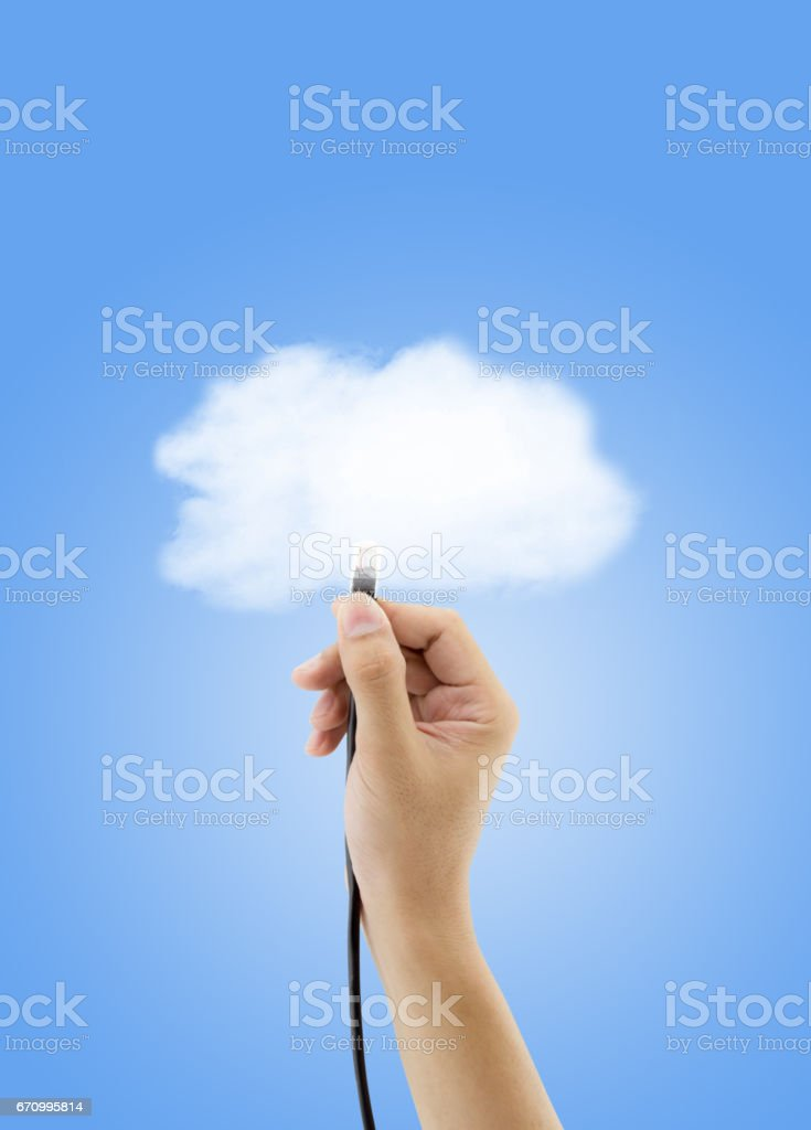 Cloud storage concept - Hand with ethernet cable connecting into cloud for network. stock photo