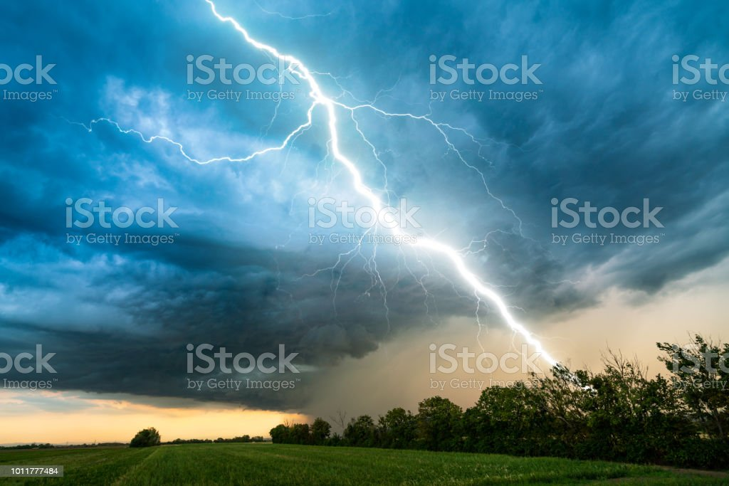cloud storm sky with thunderbolt over rural landscape royalty-free stock photo