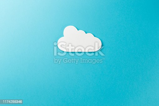 istock Cloud technology concept. Minimalistic cloud on blue background. Concept AI(Artificial Intelligence). Neural networks, machine and deep learning, and another modern technologies concepts 1174255346