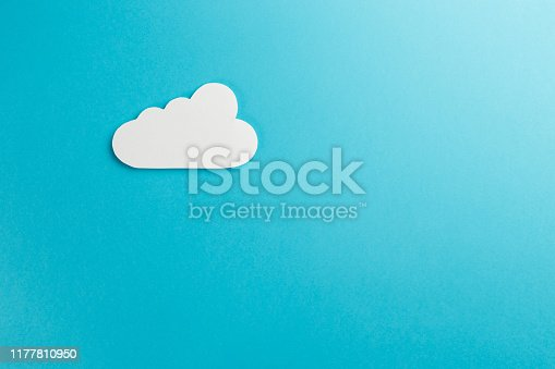 872670490istockphoto Cloud technology concept. Minimalistic cloud on blue background. Concept AI(Artificial Intelligence). Neural networks, machine and deep learning, and another modern technologies concepts 1177810950
