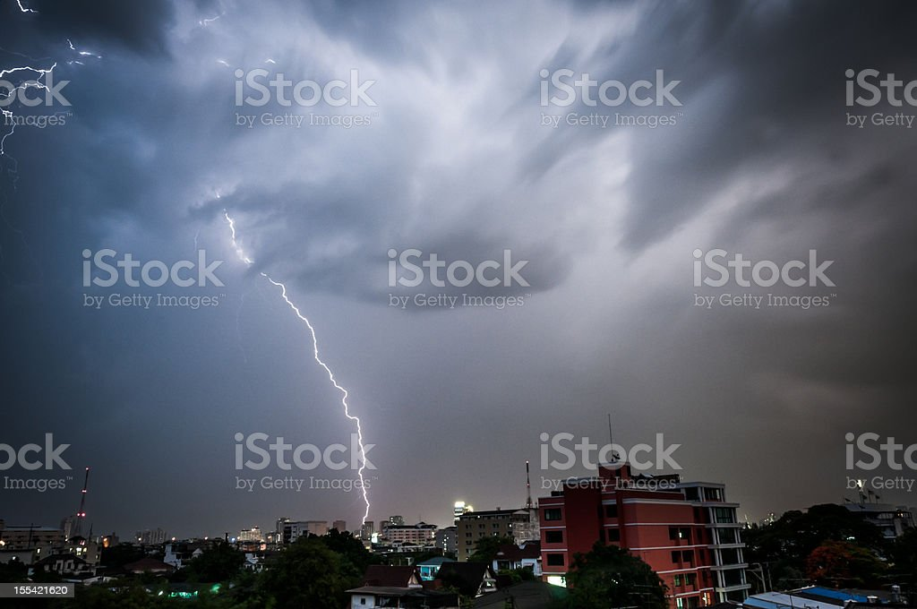 Cloud to ground lightning strike in the city stock photo