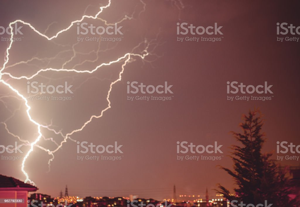 cloud to ground lightning strike in the city stock photo more