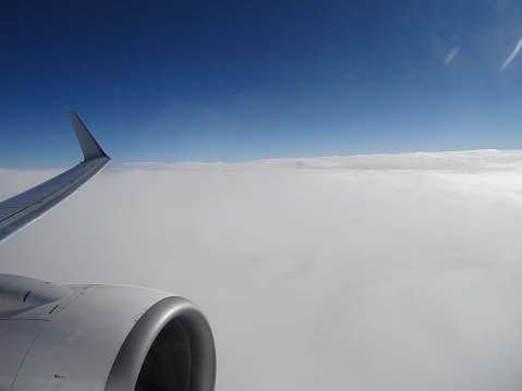 Cloud Top View From With A Jet Engine In The Foreground Stock Photo - Download Image Now