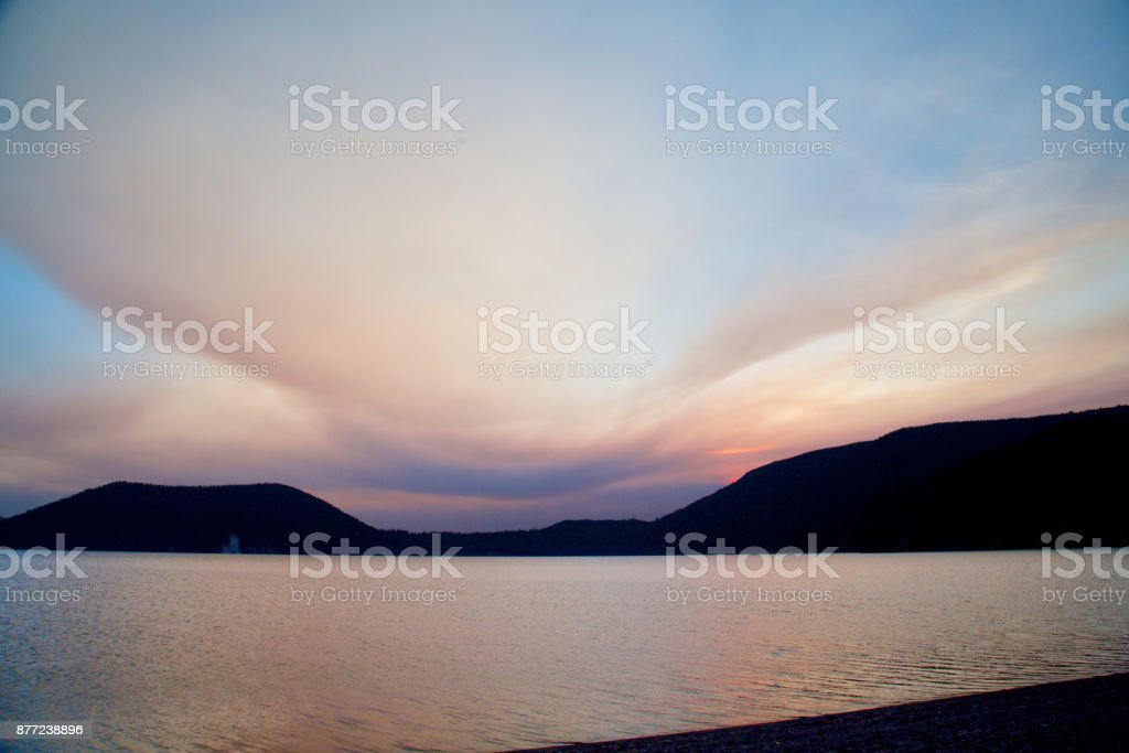 Cloud Typologies Cloud Smoky sunset over east lake in Newberry Caldera stock photo