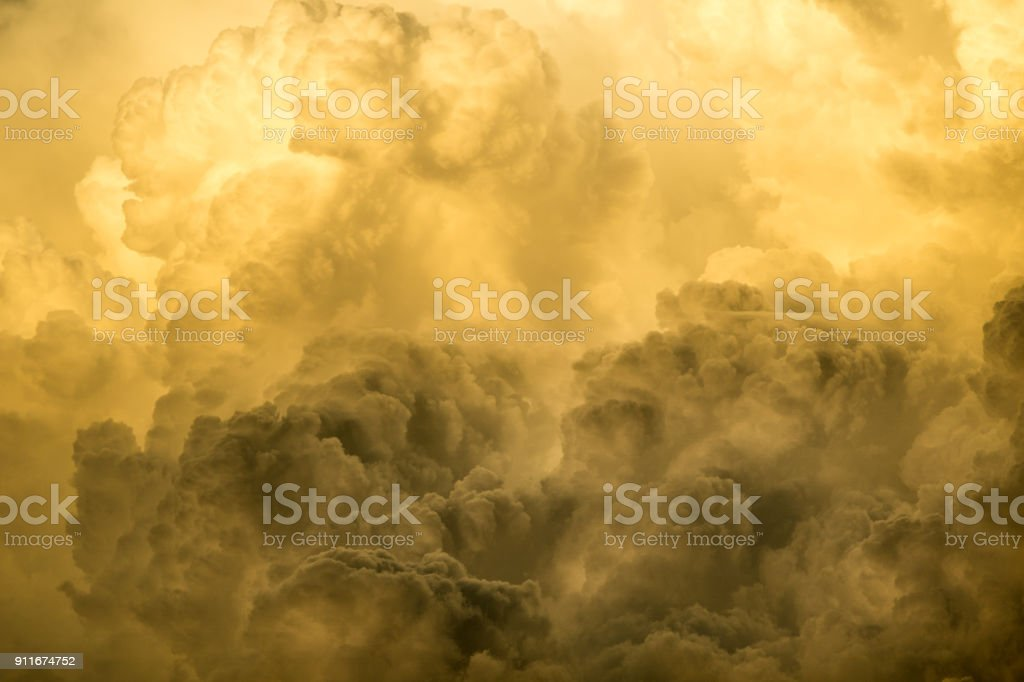 Numerous Cumulus, or Cumulonimbus, clouds are rising to form a deep,...