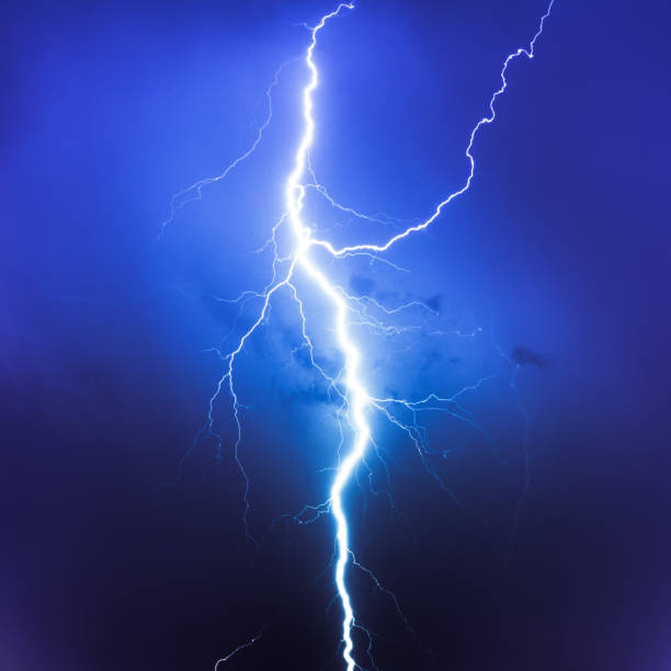Cloud Typologies, lightning on blue sky stock photo