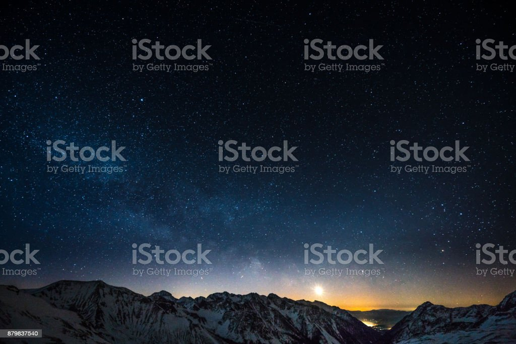 Cloud Typologies - night sky milky way milky way night sky shot from obertauern austria snow covered mountain summits and rising moon Astrology Stock Photo