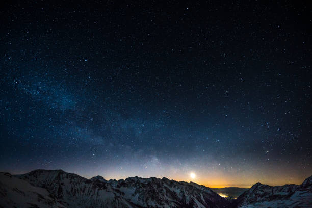 Cloud Typologies - night sky milky way milky way night sky shot from obertauern austria snow covered mountain summits and rising moon star field stock pictures, royalty-free photos & images