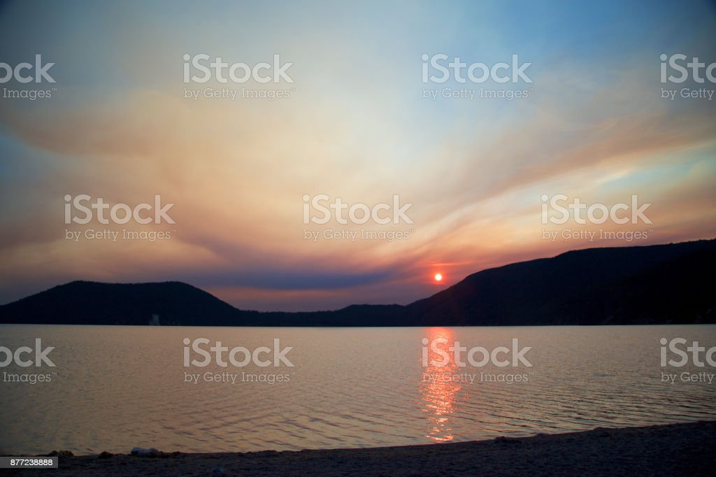Cloud Typologies - Smoky sunset over east lake in Newberry Caldera stock photo