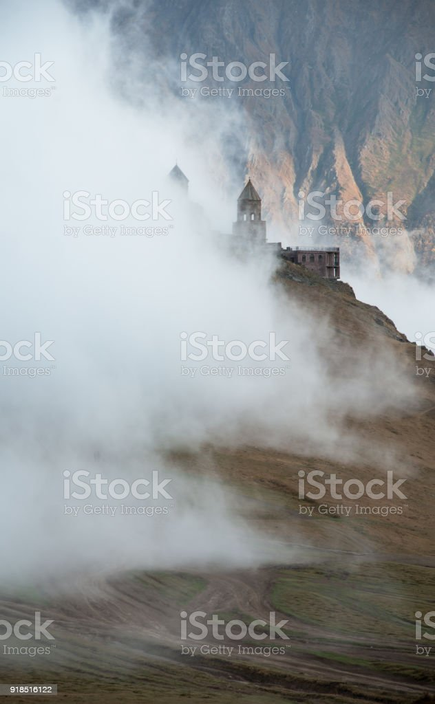 Clouded Gergeti Church stock photo