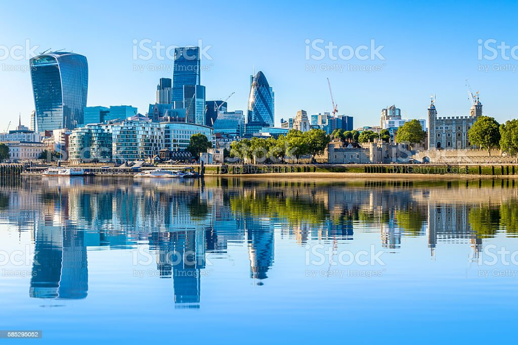 Cloudless day at financial district of London stock photo