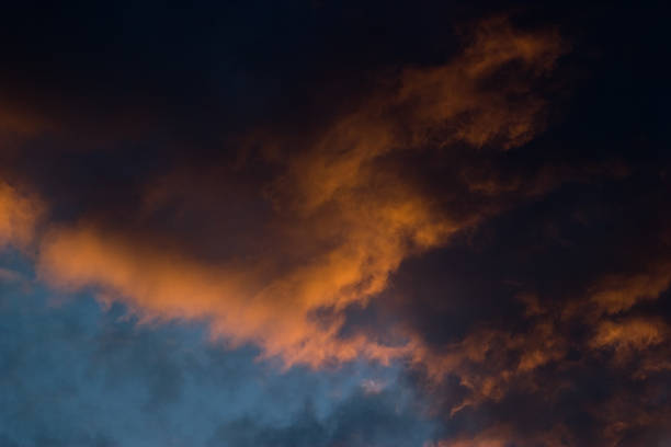 Clouds ablaze Strong contrast between the fringes of the clouds lit by the setting sun ablaze stock pictures, royalty-free photos & images