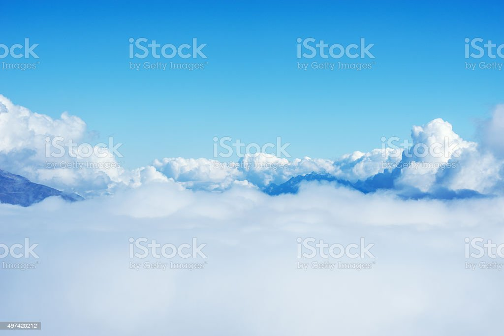 Clouds above the mountains. stock photo