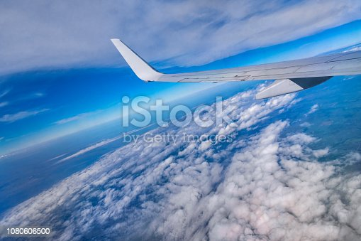 istock Clouds Aerial View with wing of airplane 1080606500