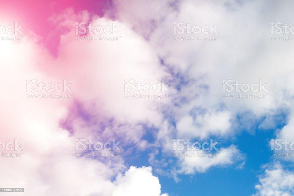 clouds against a blue sky with rays of the sun zbiór zdjęć royalty-free