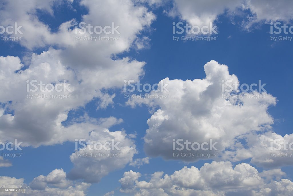 Clouds against deep blue sky stock photo