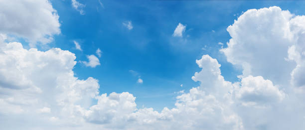 clouds and bright blue sky background, panoramic angle view stock photo