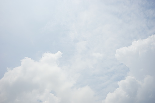 937694668 istock photo Clouds and bright blue sky background 1154597807