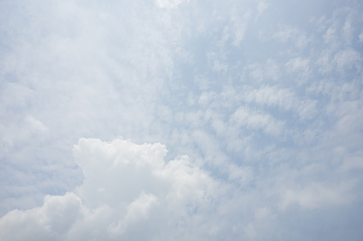 937694668 istock photo Clouds and bright blue sky background 1154597864