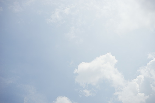 937694668 istock photo Clouds and bright blue sky background 1154598237