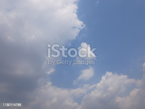istock Clouds and bright blue sky 1130114785