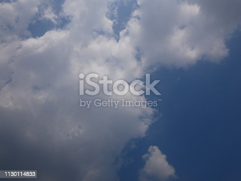 istock Clouds and bright blue sky 1130114833