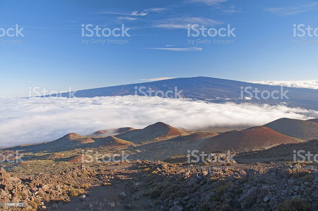 Clouds and clear skies from the Hawaiian Mountains stock photo