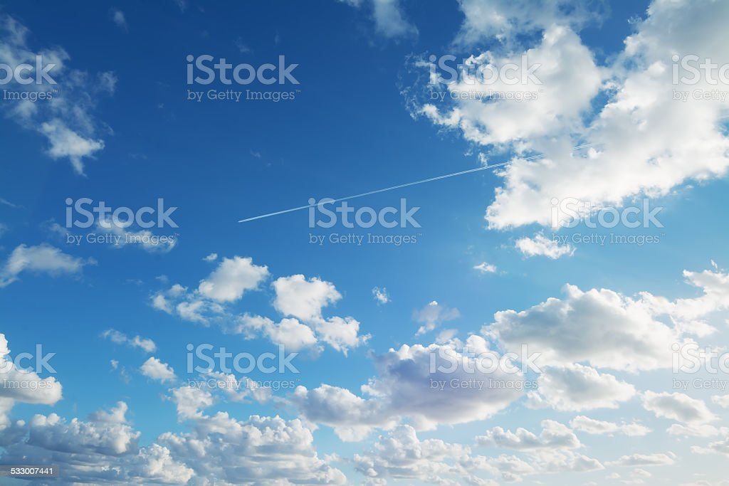 clouds and contrails stock photo