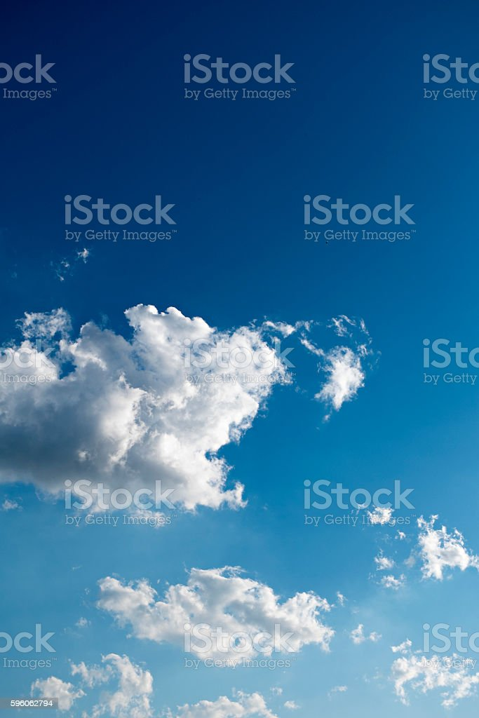 Clouds and deep blue sky a lot of copyspace royalty-free stock photo
