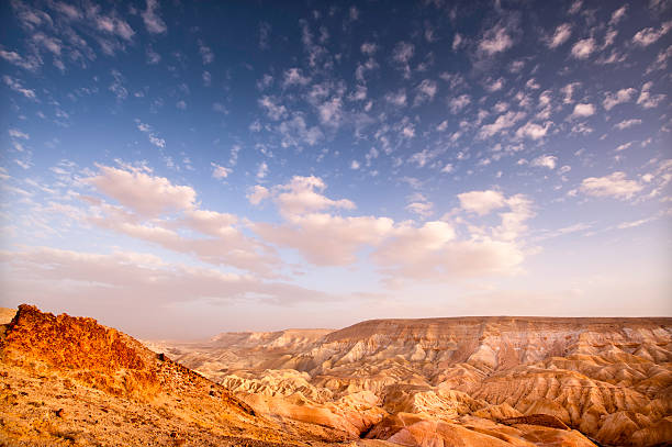 Clouds and Desert Colliding Last few minutes of light on the Valley of Zin in the Negev heading down to the Dead Sea. negev stock pictures, royalty-free photos & images